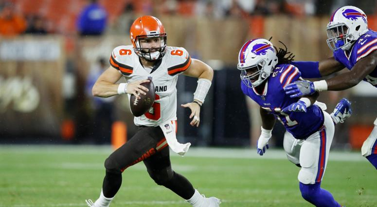 CLEVELAND, OH - AUGUST 17: Baker Mayfield #6 of the Cleveland Browns looks to pass while pursued by Julian Stanford #51 of the Buffalo Bills in the third quarter of a preseason game at FirstEnergy Stadium on August 17, 2018 in Cleveland, Ohio. (Photo by J