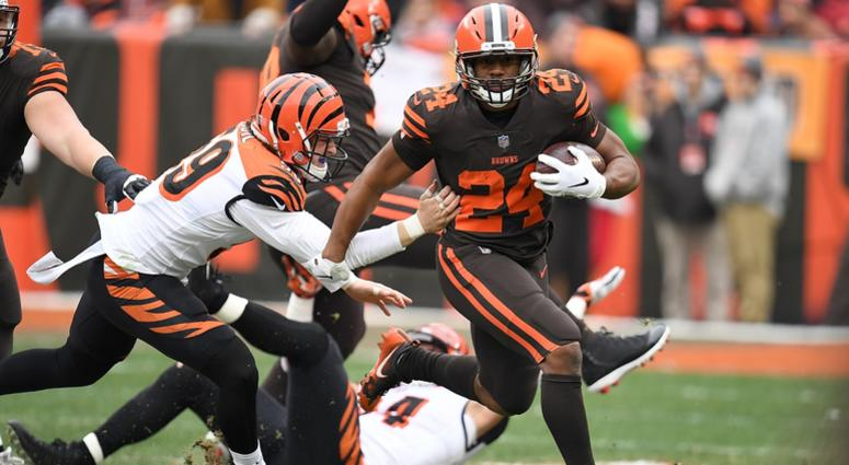 CLEVELAND, OH - DECEMBER 23: Nick Chubb #24 of the Cleveland Browns carries the ball in front of Nick Vigil #59 of the Cincinnati Bengals during the first half at FirstEnergy Stadium on December 23, 2018 in Cleveland, Ohio. (Photo by Jason Miller/Getty Im
