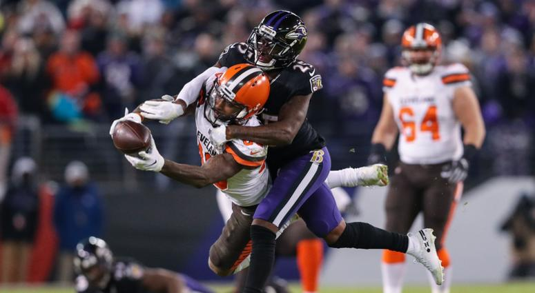 BALTIMORE, MARYLAND - DECEMBER 30: Wide Receiver Jarvis Landry #80 of the Cleveland Browns is tackled after a reception by cornerback Tavon Young #25 of the Baltimore Ravens in the fourth quarter at M&T Bank Stadium on December 30, 2018 in Baltimore, Mary