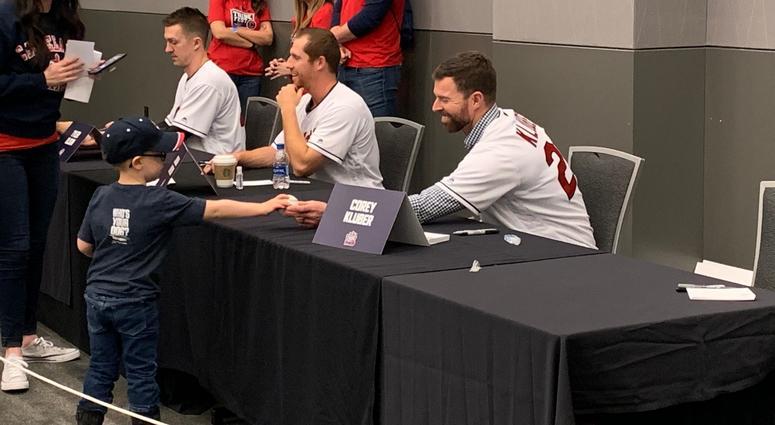 Corey Kluber hands a fresh autograph to a fan