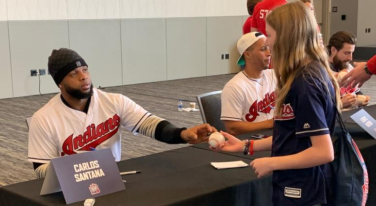 Santana hands a freshly autographed baseball back to a fan