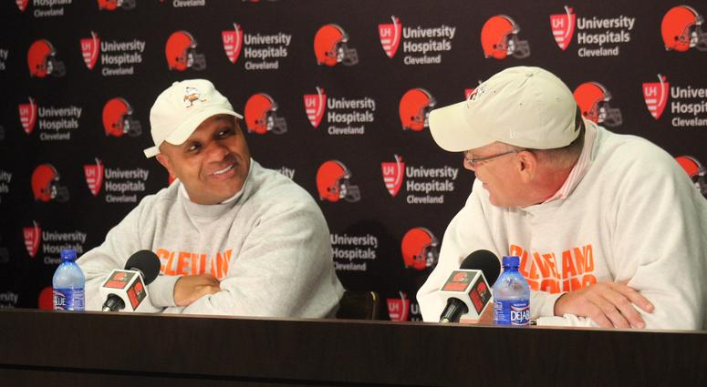 Browns head coach Hue Jackson (L) and general manager John Dorsey (R) speak with reporters on July 25, 2018.