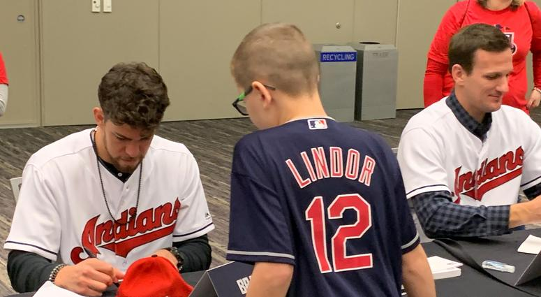 Bradley Zimmer signs for a young fan