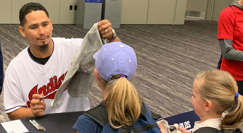 Carlos Carrasco signs for fans