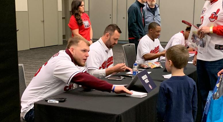 Roberto Perez hands a signed baseball back to a kid