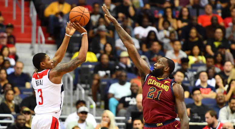 Wizards guard Bradley Beal (3) makes a three point shot over Cleveland Cavaliers center Kendrick Perkins (21) on Oct. 8, 2017.