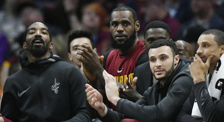 Apr 11, 2018; Cleveland, OH, USA; Cleveland Cavaliers forward LeBron James (center) sits on the bench in the fourth quarter against the New York Knicks at Quicken Loans Arena.