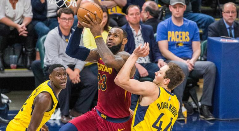 Cleveland Cavaliers forward LeBron James (23) shoots the ball while Indiana Pacers guard Darren Collison (2) and forward Bojan Bogdanovic (44) defend in the second half of game four.