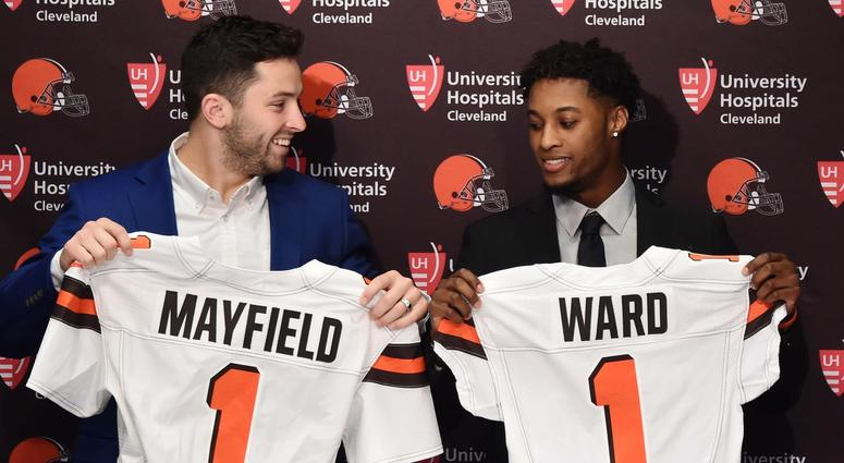 Cleveland Browns first round picks, Baker Mayfield , left, and Denzel Ward show off Browns jerseys during a press conference at the Cleveland Browns training facility.