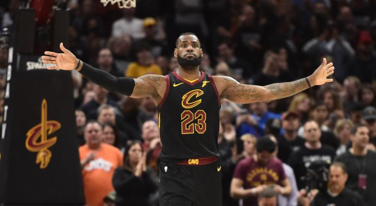 Cavaliers forward LeBron James (23) signals to his team to not defend the Indiana Pacers late in the second half in game seven of the first round of the 2018 NBA Playoffs at Quicken Loans Arena