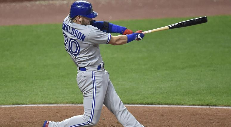 Toronto Blue Jays third baseman Josh Donaldson (20) hits a solo home run in the fourth inning against the Cleveland Indians at Progressive Field.