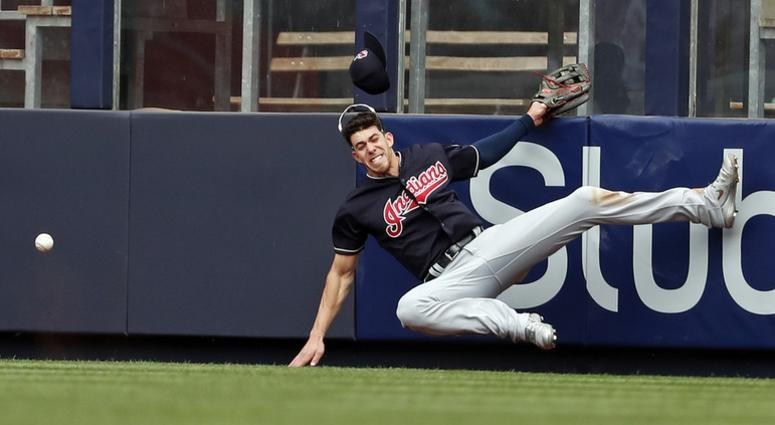 May 5, 2018; Bronx, NY, USA; Cleveland Indians center fielder Bradley Zimmer (4) collides with the wall attempting to catch a double by New York Yankees catcher Austin Romine (28) during the seventh inning at Yankee Stadium. Mandatory Credit: Adam Hunger-