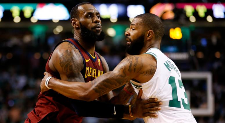Celtics forward Marcus Morris (13) defends Cleveland Cavaliers forward LeBron James (23) during the second quarter of game two of the Eastern conference finals of the 2018 NBA Playoffs at TD Garden.