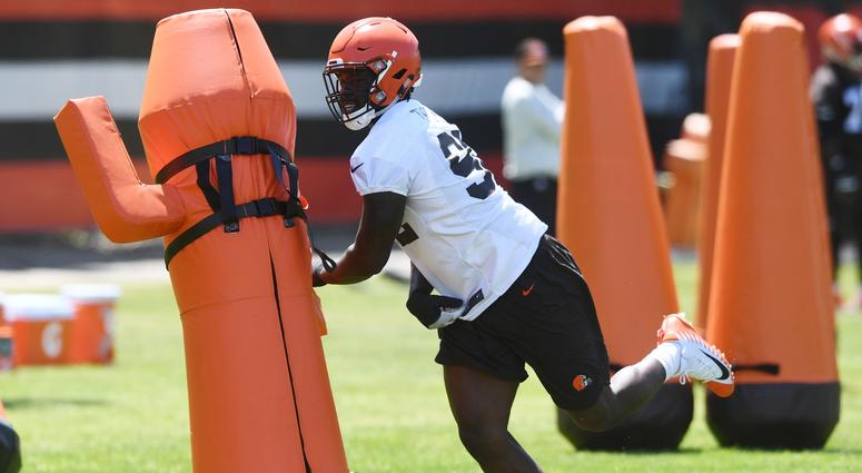 Cleveland Browns defensive lineman Chad Thomas (92) runs a drill during organized team activities at the Cleveland Browns training facility.