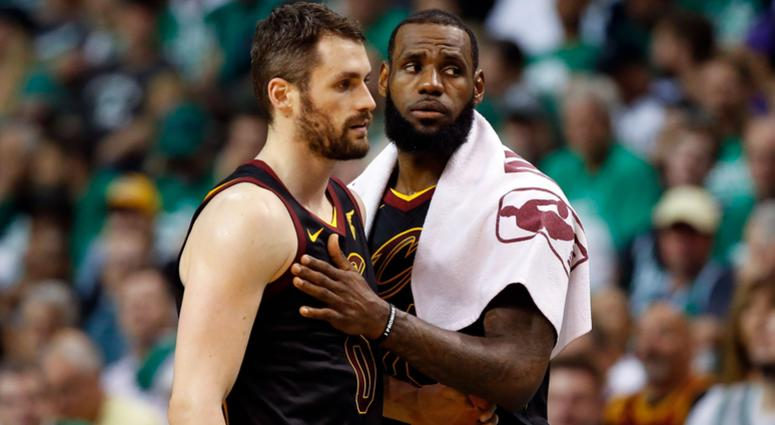 Cleveland Cavaliers center Kevin Love (0) and forward LeBron James (23) talk during the second quarter of game five against the Boston Celtics in the Eastern conference finals of the 2018 NBA Playoffs at TD Garden.