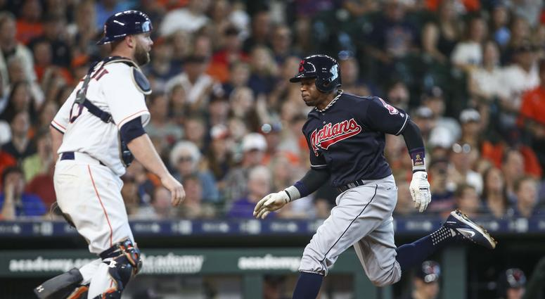 May 19, 2018; Houston, TX, USA; Cleveland Indians center fielder Rajai Davis (26) scores a run as Houston Astros catcher Brian McCann (16) looks on during the fifth inning at Minute Maid Park.