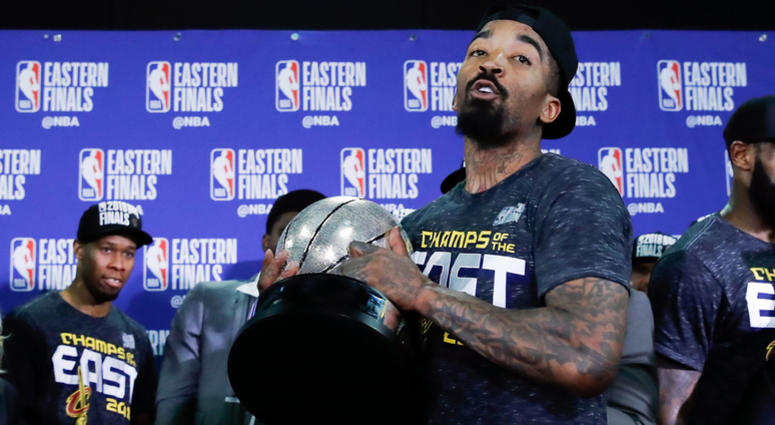 Cleveland Cavaliers guard JR Smith (5) picks up the Eastern Conference trophy after defeating the Boston Celtics in the 2018 NBA Playoffs at TD Garde