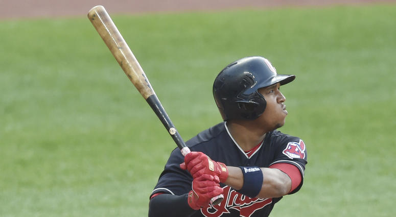 May 29, 2018; Cleveland, OH, USA; Cleveland Indians third baseman Jose Ramirez (11) hits a solo home run in the fifth inning against the Chicago White Sox at Progressive Field.
