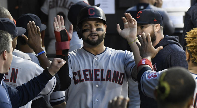 Jun 11, 2018; Chicago, IL, USA; Cleveland Indians first baseman Yonder Alonso (17)is greeted by his teammates after scoring against the Chicago White Sox during the fourth inning at Guaranteed Rate Field.