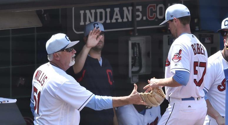 Jun 17, 2018; Cleveland, OH, USA; Cleveland Indians pitching coach Carl Willis (51) congratulates starting pitcher Shane Bieber (57) in the sixth inning against the Minnesota Twins at Progressive Field.