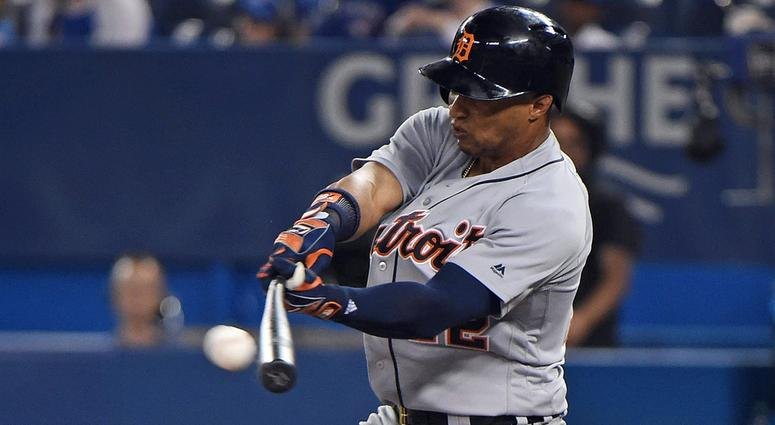 Detroit Tigers center fielder Leonys Martin (12) hits a single against Toronto Blue Jays in the eighth inning at Rogers Centre.