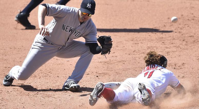 Jul 15, 2018; Cleveland, OH, USA; Cleveland Indians third baseman Jose Ramirez (11) steals second base beside New York Yankees second baseman Neil Walker (14) in the eighth inning at Progressive Field.