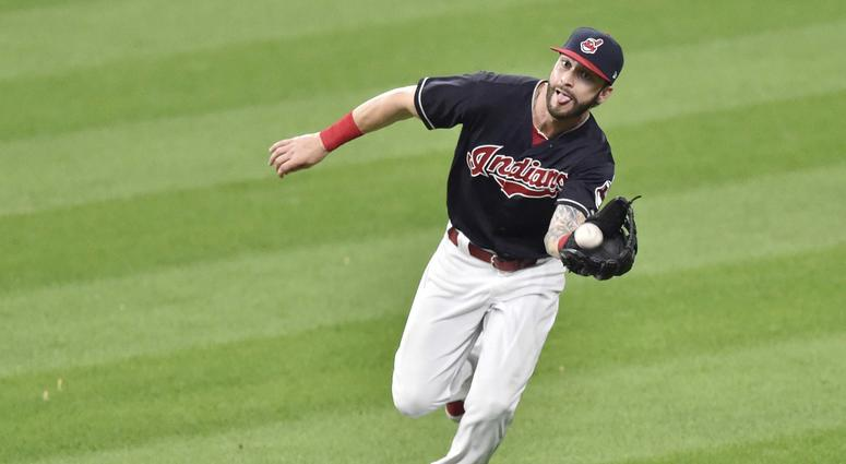 Jul 24, 2018; Cleveland, OH, USA; Cleveland Indians center fielder Tyler Naquin (30) makes a catch in the eighth inning against the Pittsburgh Pirates at Progressive Field.