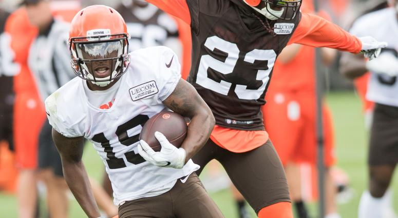Cleveland Browns wide receiver Corey Coleman (19) runs with the ball as defensive back Damarious Randall (23) defends during training camp at the Cleveland Browns Training Complex.