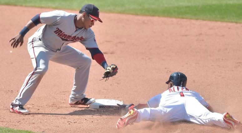 Aug 9, 2018; Cleveland, OH, USA; Cleveland Indians center fielder Greg Allen (1) steals second base beside Minnesota Twins shortstop Jorge Polanco (11) in the ninth inning at Progressive Field.