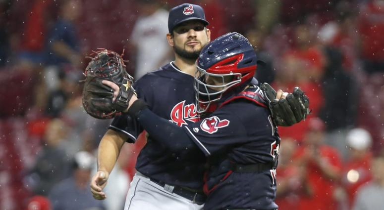 Aug 15, 2018; Cincinnati, OH, USA; Cleveland Indians relief pitcher Brad Hand (33) and catcher Roberto Perez (55) congratulate each other after the Indians beat the Cincinnati Reds at Great American Ball Park. Mandatory Credit: David Kohl-USA TODAY Sports