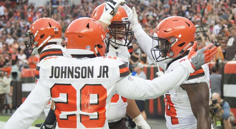 Cleveland Browns running back Carlos Hyde, right, celebrates his first quarter touchdown with running back Duke Johnson (29) and center JC Tretter (64) against the Buffalo Bills at FirstEnergy Stadium.