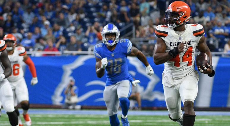 Cleveland Browns defensive end Nate Orchard (44) runs for a touchdown after making an interception during the second quarter against the Detroit Lions at Ford Field
