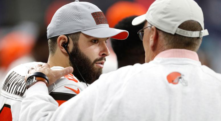 Cleveland Browns quarterback Baker Mayfield (6) talks with general manager John Dorsey (right) during the third quarter against the Detroit Lions at Ford Field.