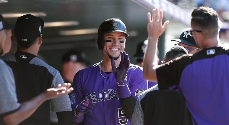 Sep 13, 2018; Denver, CO, USA; Colorado Rockies right fielder Carlos Gonzalez (5) celebrates in the dugout after scoring on a bases loaded walk in the seventh inning against the Arizona Diamondbacks at Coors Field. Mandatory Credit: Isaiah J. Downing-USA