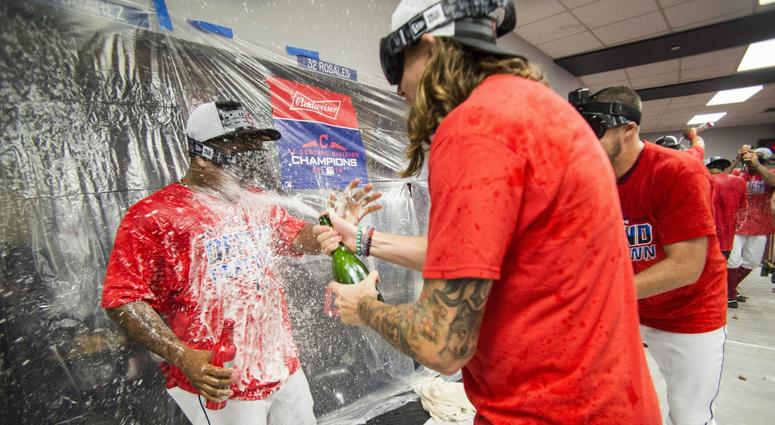 Sep 15, 2018; Cleveland, OH, USA; Cleveland Indians starting pitcher Mike Clevinger (middle) and second baseman Jose Ramirez (left) and starting pitcher Trevor Bauer (right) celebrate after defeating the Detroit Tigers to clinch the American League Centra