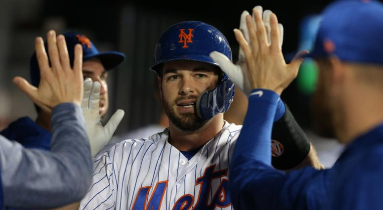 Sep 27, 2018; New York City, NY, USA; New York Mets catcher Kevin Plawecki (26) celebrates in the dugout with teammates after hitting a solo home run against the Atlanta Braves during the third inning at Citi Field. Mandatory Credit: Brad Penner-USA TODAY
