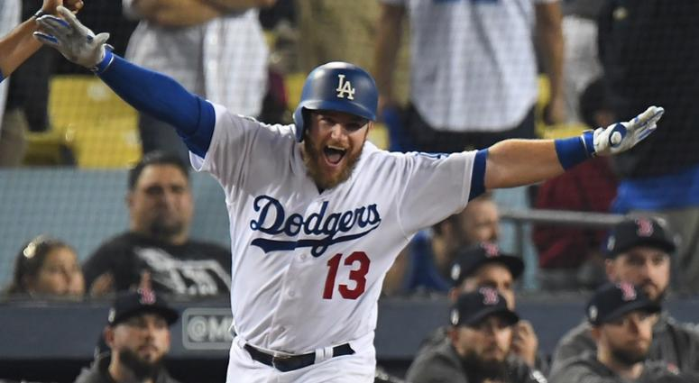 Los Angeles Dodgers first baseman Max Muncy (13) celebrates with first base coach George Lombard (29) after hitting a solo home run against the Boston Red Sox in the eighteenth inning to win game three of the 2018 World Series at Dodger Stadium.