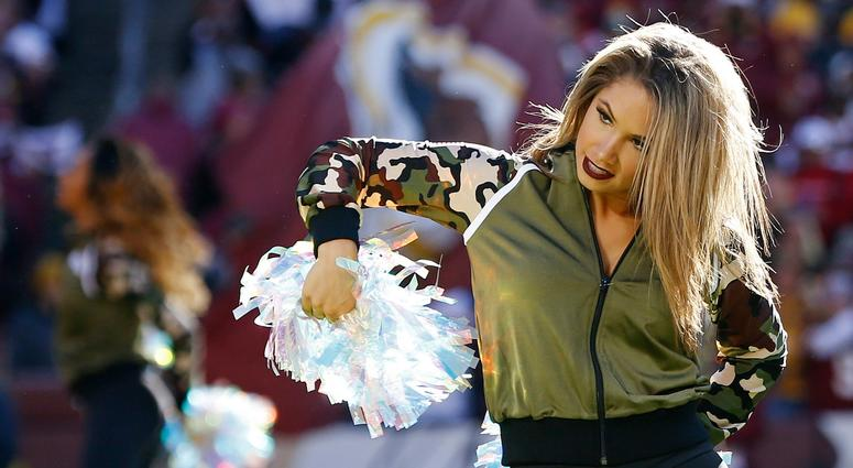 Nov 4, 2018; Landover, MD, USA; A Washington Redskins cheerleader dances on the field during a timeout against the Atlanta Falcons in the second quarter at FedEx Field. Mandatory Credit: Geoff Burke-USA TODAY Sports