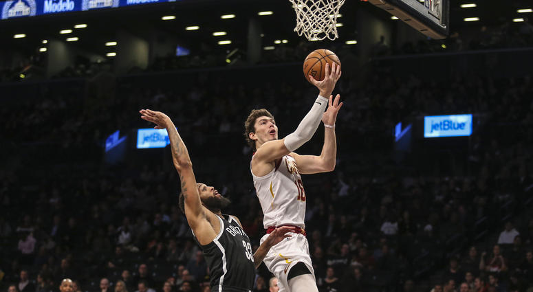 Dec 3, 2018; Brooklyn, NY, USA; Cleveland Cavaliers forward Cedi Osman (16) goes in for the layup in the second quarter against the Brooklyn Nets at Barclays Center. Mandatory Credit: Wendell Cruz-USA TODAY Sports
