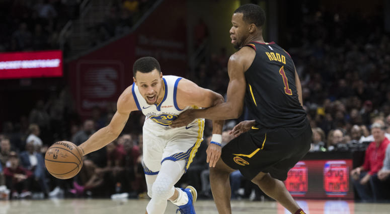 Dec 5, 2018; Cleveland, OH, USA; Golden State Warriors guard Stephen Curry (30) drives to the basket against Cleveland Cavaliers guard Rodney Hood (1) during the first half at Quicken Loans Arena. Mandatory Credit: Ken Blaze-USA TODAY Sports