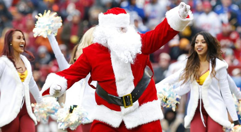 Dec 9, 2018; Landover, MD, USA; Santa Claus dances with Washington Redskins cheerleaders on the field during a timeout against the New York Giants in the second quarter at FedEx Field. The Giants won 40-16. Mandatory Credit: Geoff Burke-USA TODAY Sports