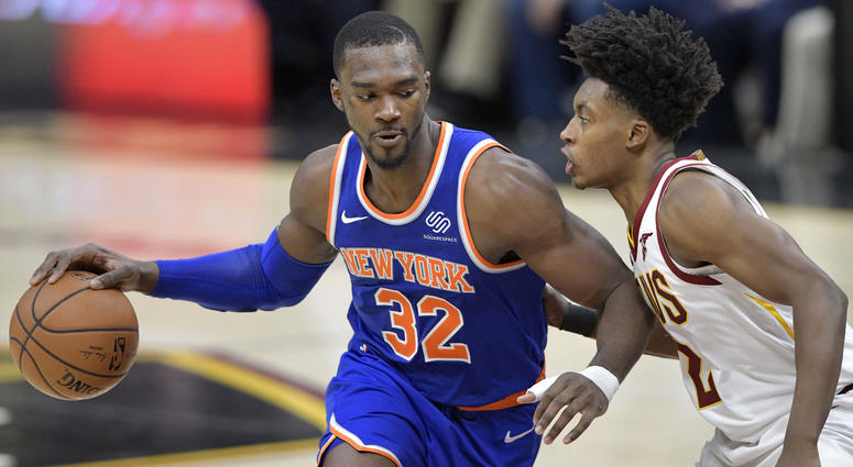 Dec 12, 2018; Cleveland, OH, USA; New York Knicks forward Noah Vonleh (32) drives against Cleveland Cavaliers guard Collin Sexton (2) in the second quarter at Quicken Loans Arena. Mandatory Credit: David Richard-USA TODAY Sports