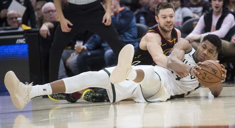 Cleveland Cavaliers guard Matthew Dellavedova (18) and Milwaukee Bucks forward Giannis Antetokounmpo (34) battle for a loose ball during the second half at Quicken Loans Arena.