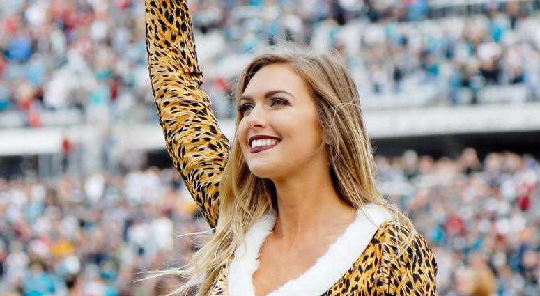 Dec 16, 2018; Jacksonville, FL, USA;Jacksonville Jaguars cheerleader cheers against the Washington Redskins during the first half at TIAA Bank Field. Mandatory Credit: Kim Klement-USA TODAY Sports