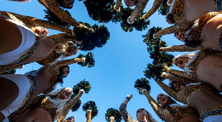 Dec 16, 2018; Jacksonville, FL, USA; Jacksonville Jaguars cheerleaders make a final cheer in a huddle after the final home game of the season between the Jacksonville Jaguars and the Washington Redskins at TIAA Bank Field. Mandatory Credit: Douglas DeFeli