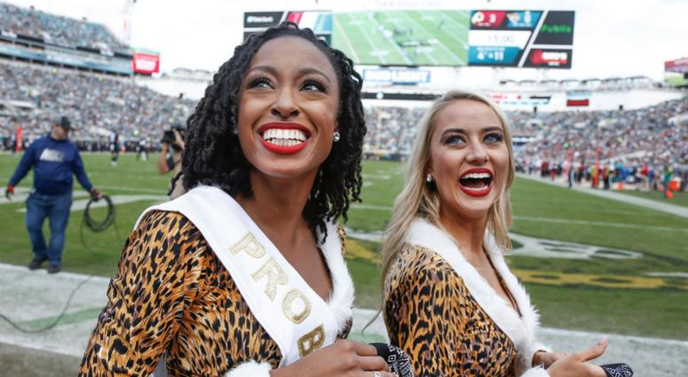 Dec 16, 2018; Jacksonville, FL, USA; Jacksonville Jaguars cheerleader Jada (left) smiles after being selected to represent her team at the Pro Bowl during the first quarter against the Washington Redskins at TIAA Bank Field. Mandatory Credit: Reinhold Mat