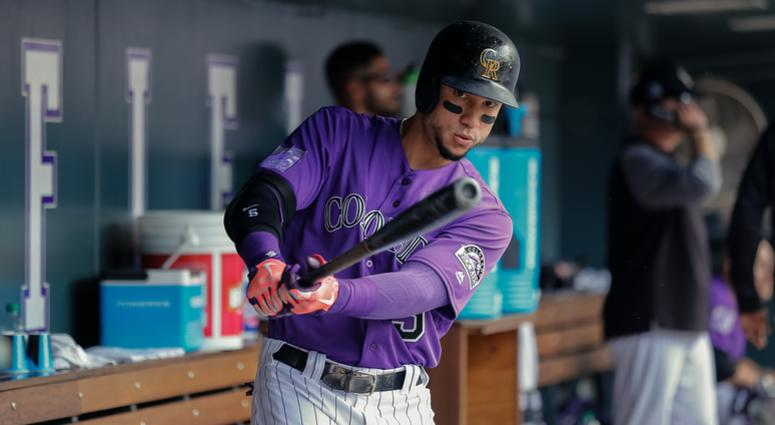 Sep 27, 2018; Denver, CO, USA; Colorado Rockies right fielder Carlos Gonzalez (5) in the dugout in the seventh inning against the Philadelphia Phillies at Coors Field. Mandatory Credit: Isaiah J. Downing-USA TODAY Sports