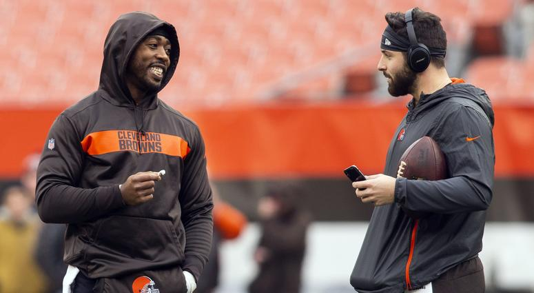 Dec 23, 2018; Cleveland, OH, USA; Cleveland Browns quarterbacks Tyrod Taylor (left) and Baker Mayfield talk during warmups before the game against the Cincinnati Bengals at FirstEnergy Stadium. Mandatory Credit: Scott R. Galvin-USA TODAY Sports