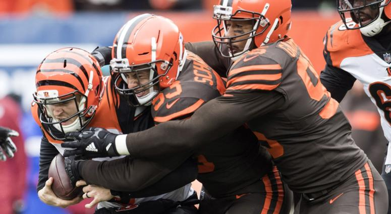 Dec 23, 2018; Cleveland, OH, USA; Cleveland Browns middle linebacker Joe Schobert (53) and defensive end Myles Garrett (95) tackle Cincinnati Bengals quarterback Jeff Driskel (6) during the first quarter at FirstEnergy Stadium. Mandatory Credit: Ken Blaze