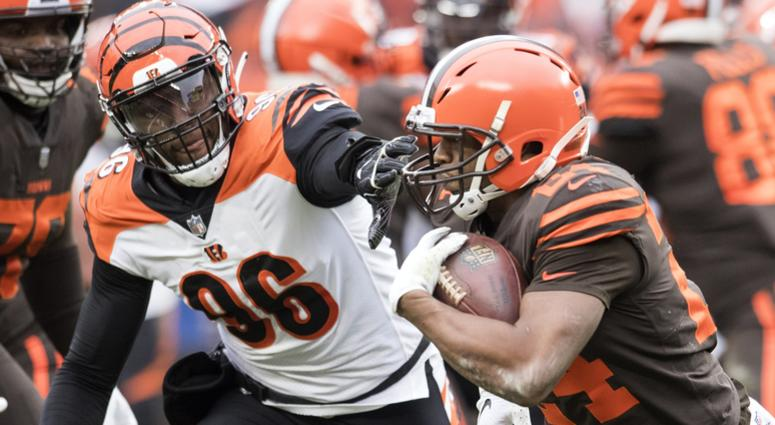 Dec 23, 2018; Cleveland, OH, USA; Cleveland Browns running back Nick Chubb (24) runs with the ball as Cincinnati Bengals defensive end Carlos Dunlap (96) goes for the tackle during the first half at FirstEnergy Stadium. Mandatory Credit: Ken Blaze-USA TOD